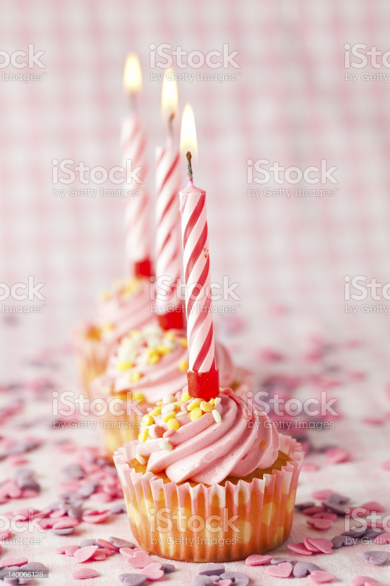 Pink muffins with candles royalty-free stock photo