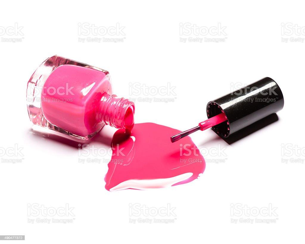 Pink nail polish and brush on white background stock photo