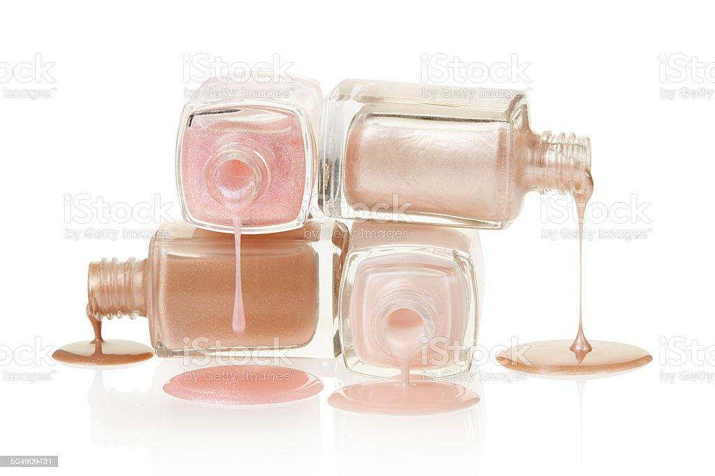 Pink nail polish spilled stock photo