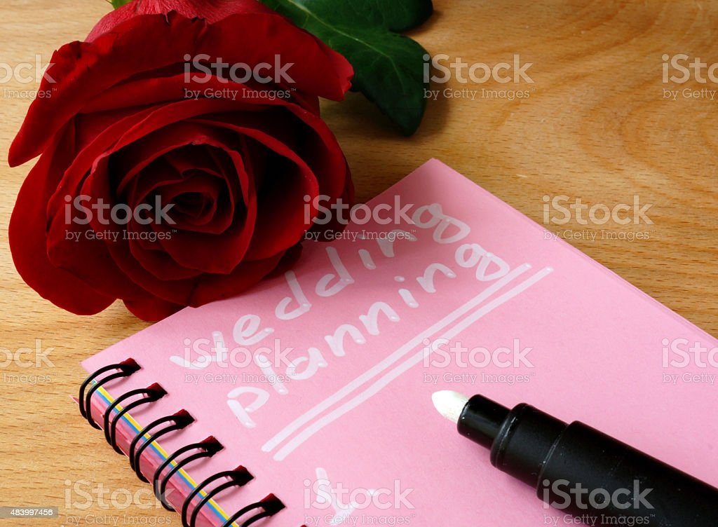 Pink notepad with wedding planning and rose stock photo
