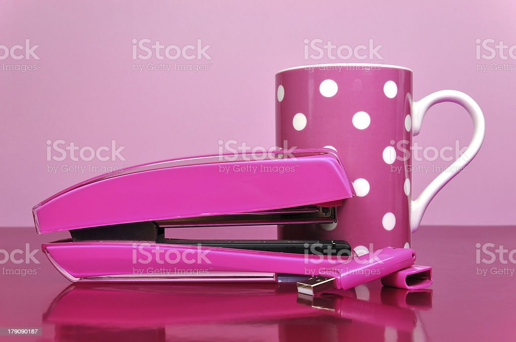 Pink office accessories with coffee mug royalty-free stock photo