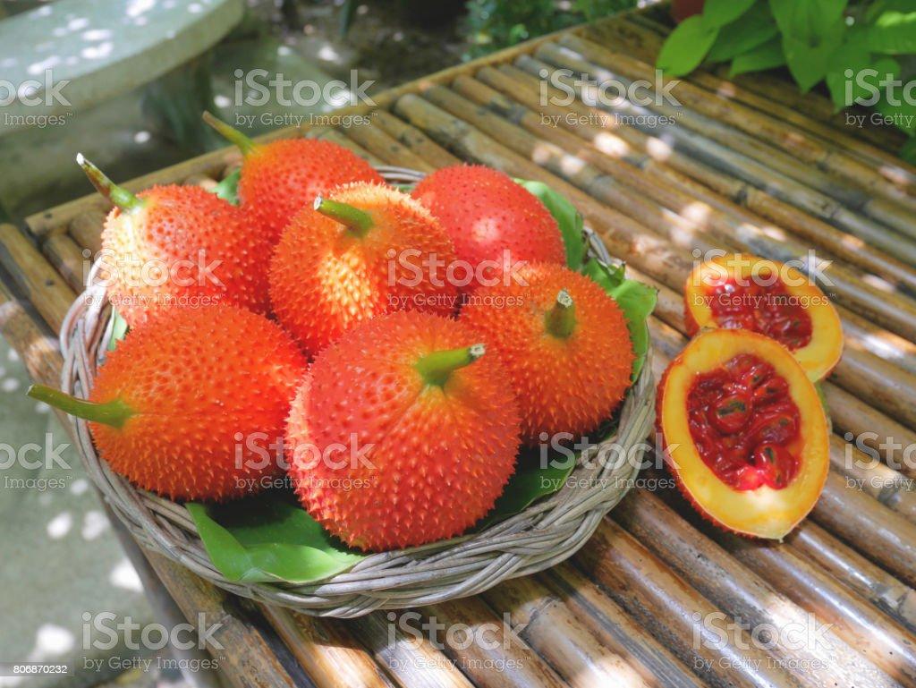 Pink, orange and green baby jackfruit in a basket stock photo