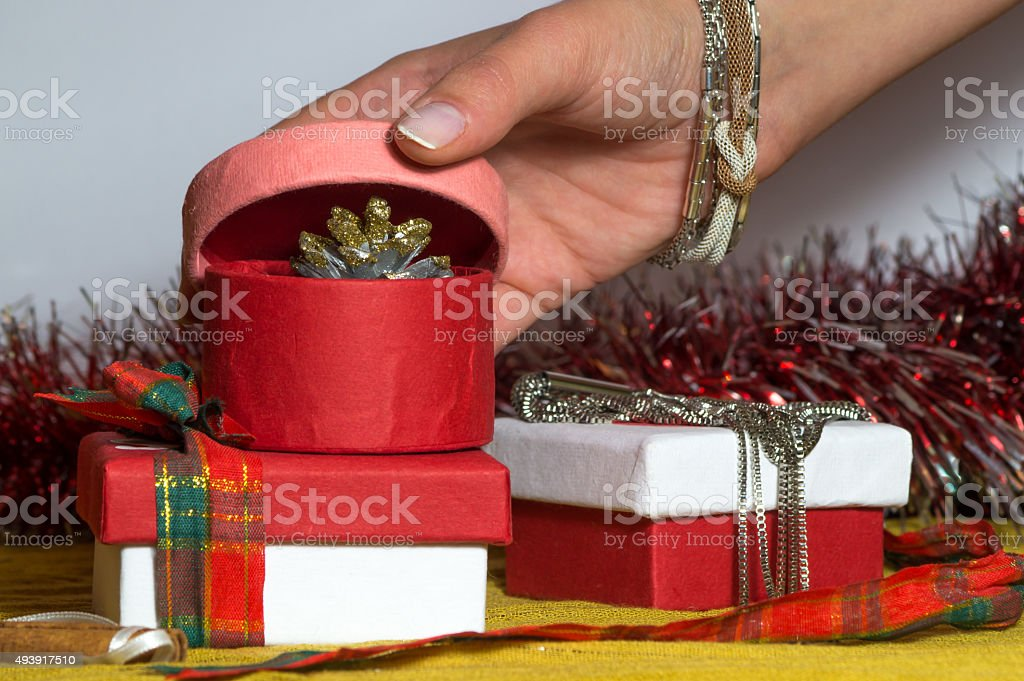 Pink paper Christmas box is being opened stock photo