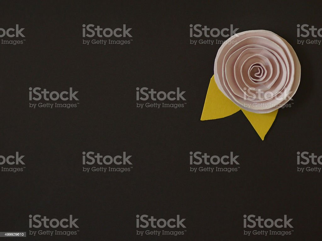 Pink paper flower on a brown background stock photo