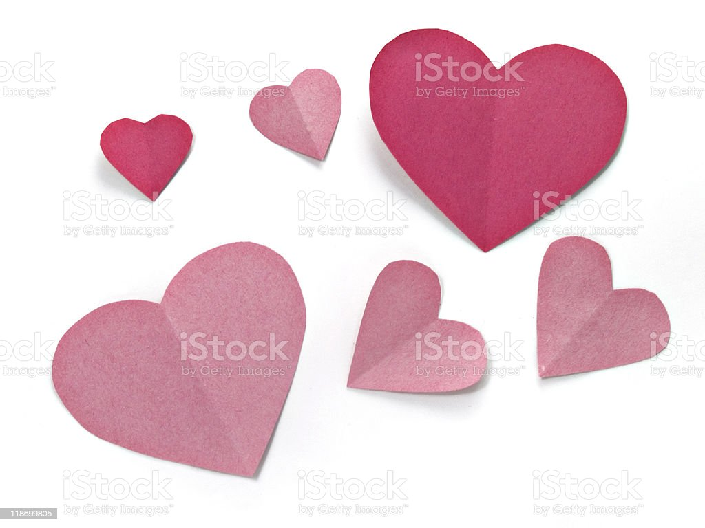 Pink paper hearts on white background stock photo