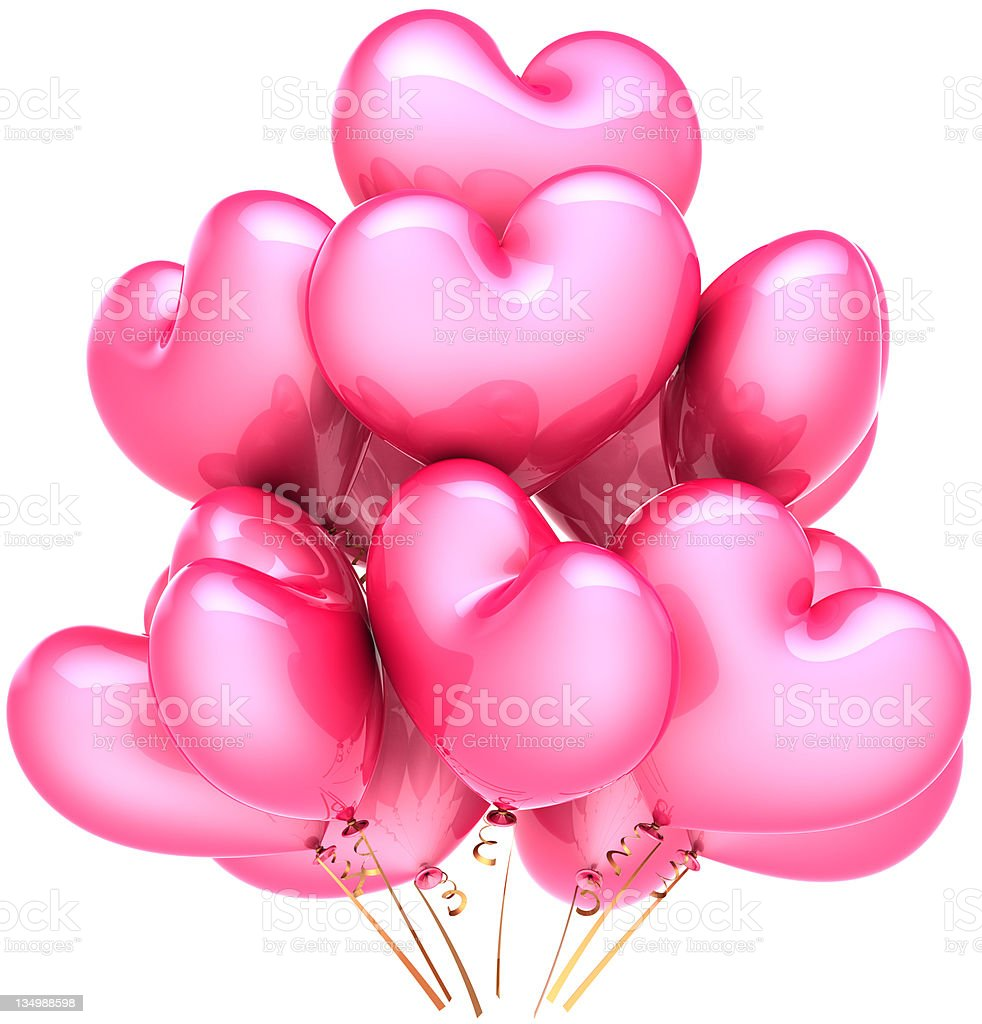 Pink party birthday balloons in form of heart shapes royalty-free stock photo