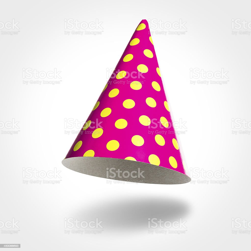 Pink party hat in air, yellow spots isolated on white stock photo