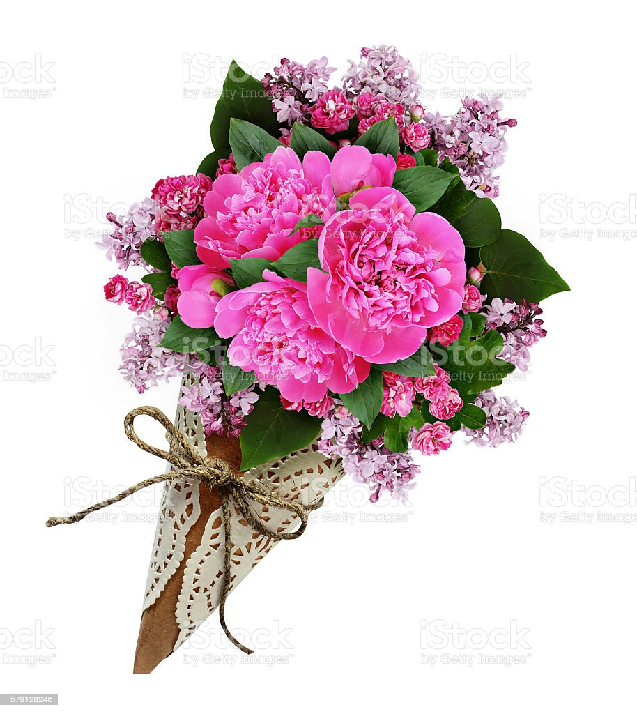 Pink peony flowers bouquet in a craft paper cornet stock photo