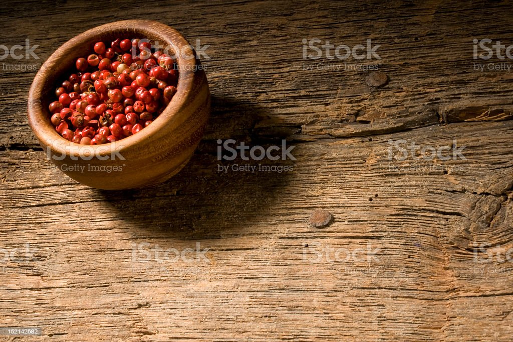 Pink pepper in a wooden bowl. royalty-free stock photo