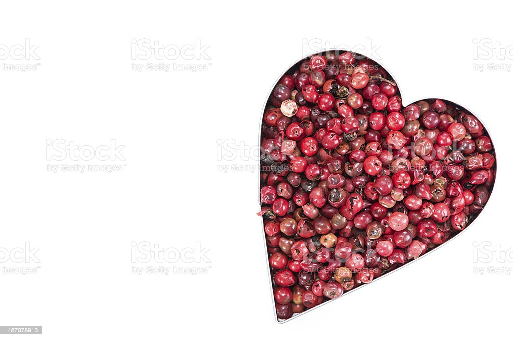 Pink Peppercorns Heart Shape (on white) royalty-free stock photo