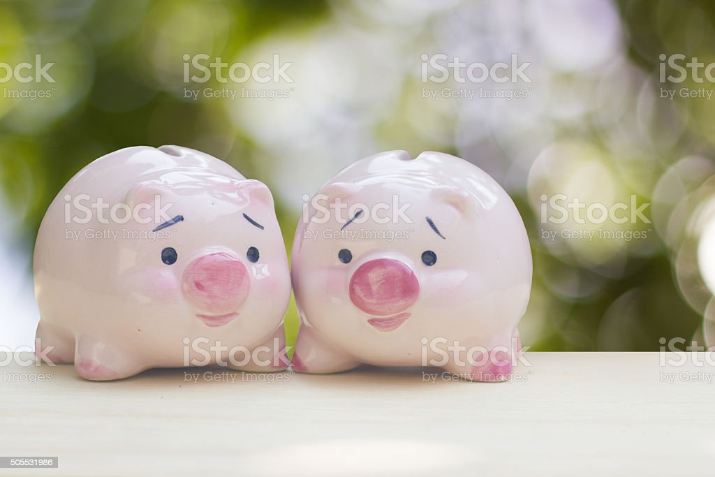 pink piggy bank lover on green bokeh background stock photo