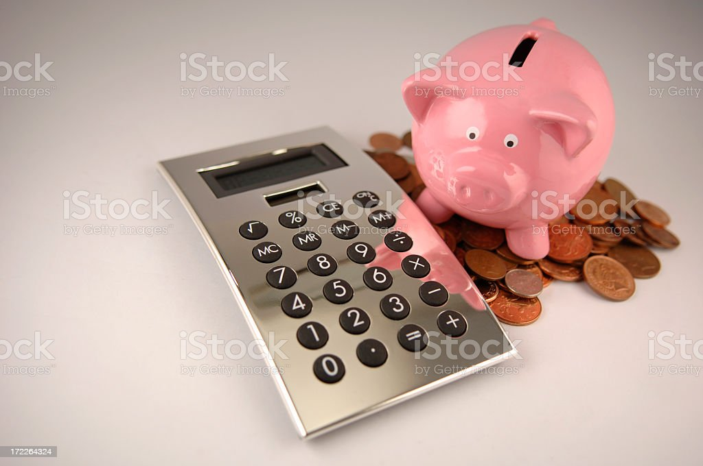 Pink Piggy Bank, Pile of Coins and Silver Calculator royalty-free stock photo