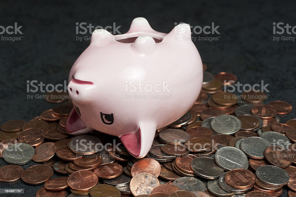 Pink Piggy Bank Tits-Up on Coins stock photo