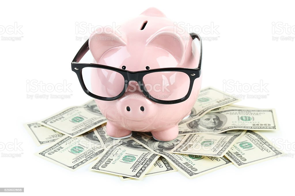 Pink piggy bank with glasses stock photo