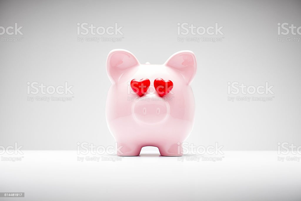 Pink Piggy Bank with Heart Shaped Eyes stock photo