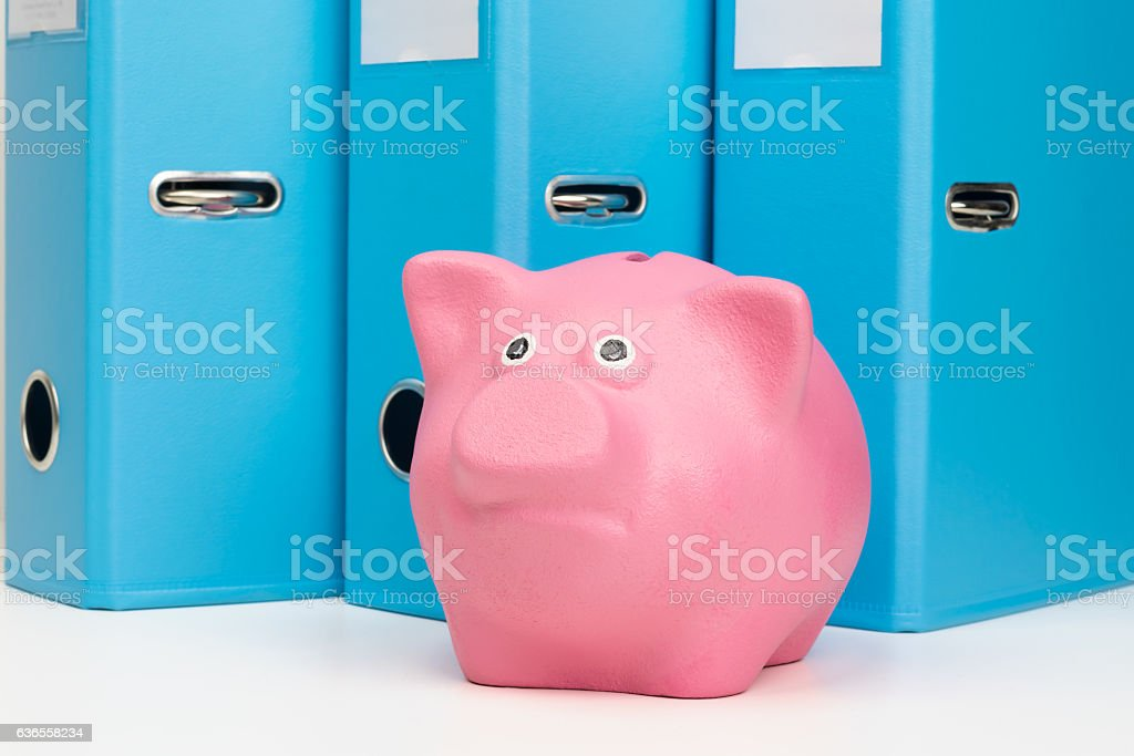 pink piggy bank with money is on the table stock photo