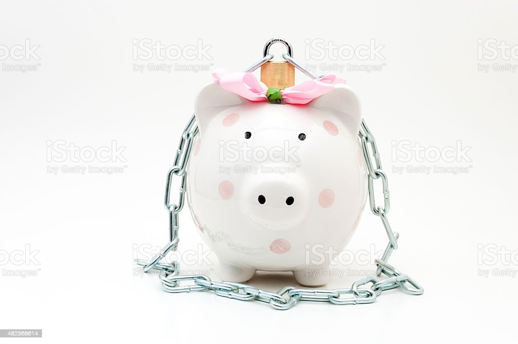 Pink piggy bank with padlock and chain stock photo