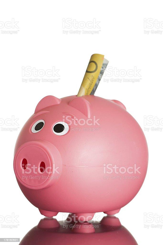 Pink piggy-bank with australian money royalty-free stock photo