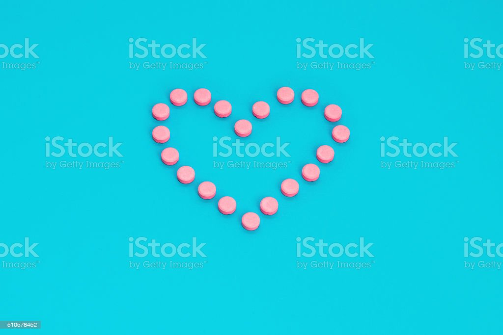 Pink Pills In Heart Shape stock photo