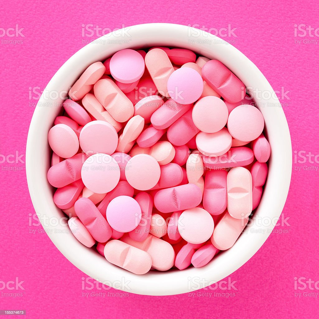 Pink pills stock photo