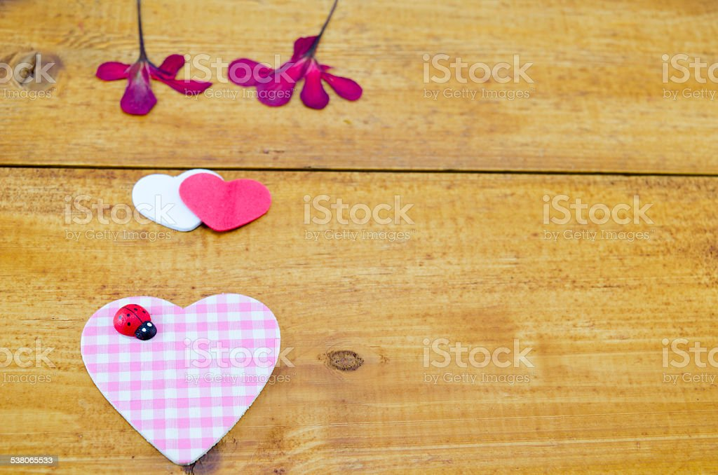 Pink plaided heart and some dried flowers royalty-free stock photo