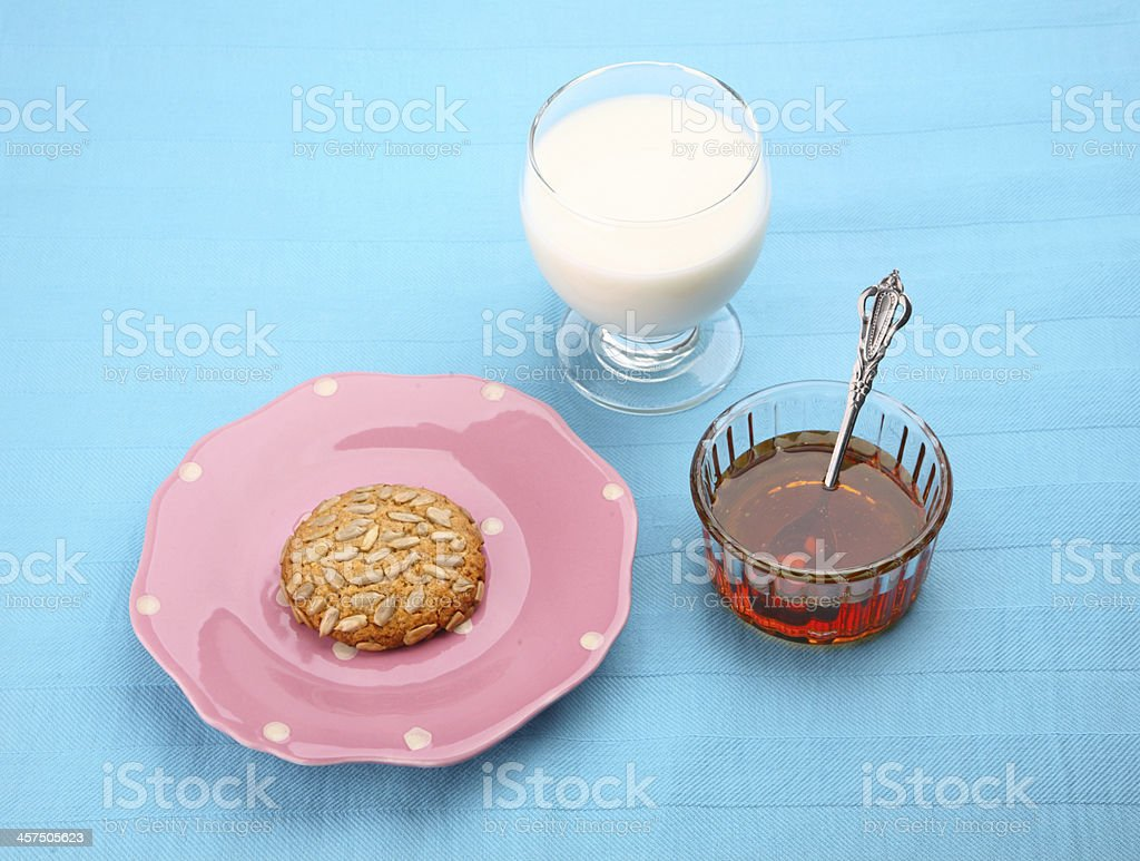 pink plate with sunflower seed cookie stock photo