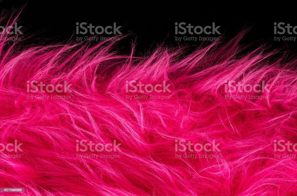 Pink plush fabric on black background horizontal stock photo
