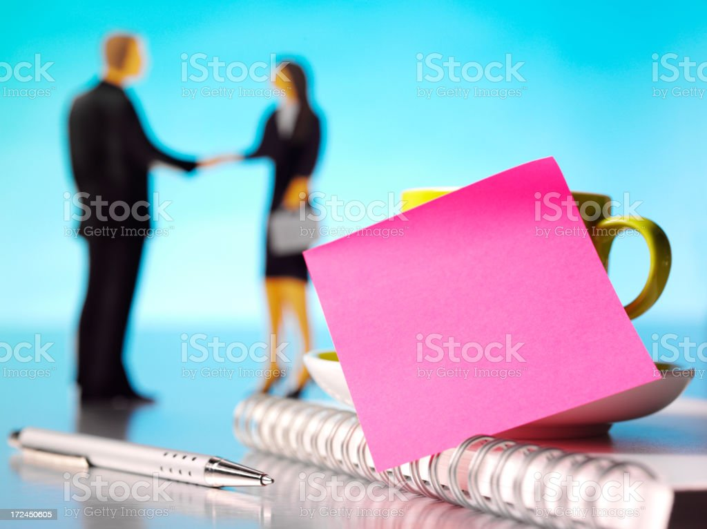 Pink Post it Note in the Office with Business People royalty-free stock photo