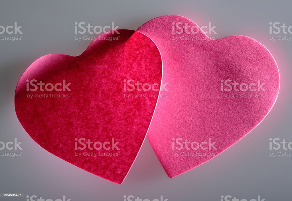 Pink post-it adhesive note in heart shape stock photo