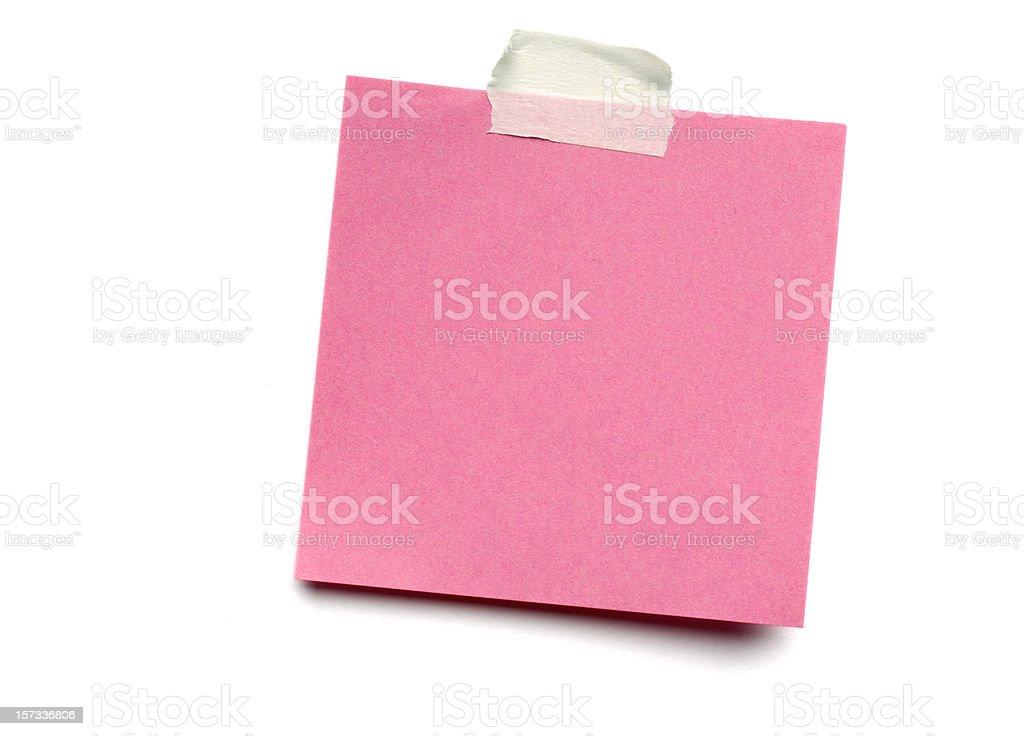 Pink postit note on white stock photo