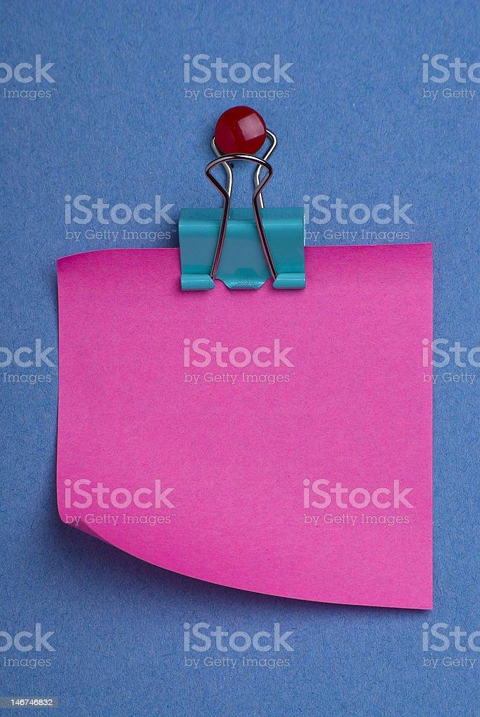 Pink postit on blue stock photo