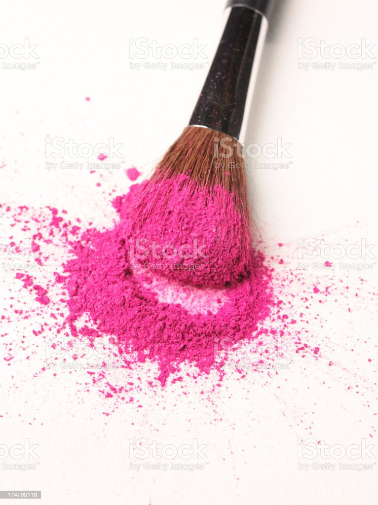 Pink Powder Make-Up on a Cosmetic Brush. royalty-free stock photo