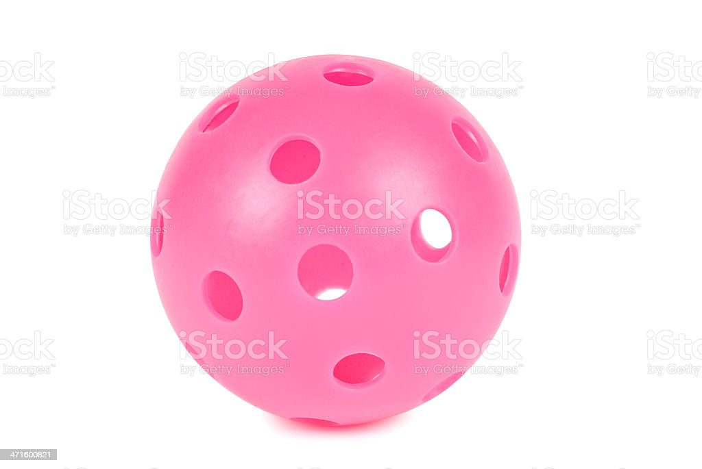 Pink practice golf ball with holes isolated on white. royalty-free stock photo