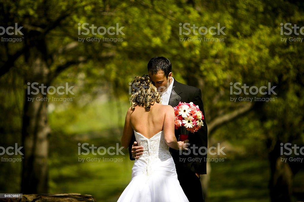 Pink Praying Christian Intimate Bride and Groom Wedding Dress royalty-free stock photo