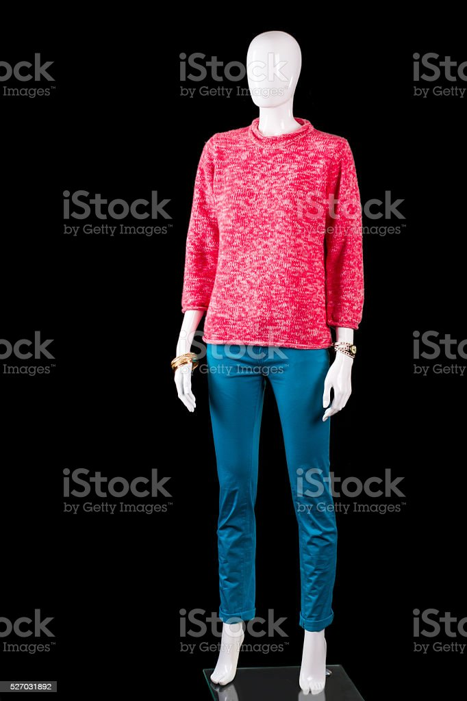 Pink pullover with tuquoise pants. stock photo