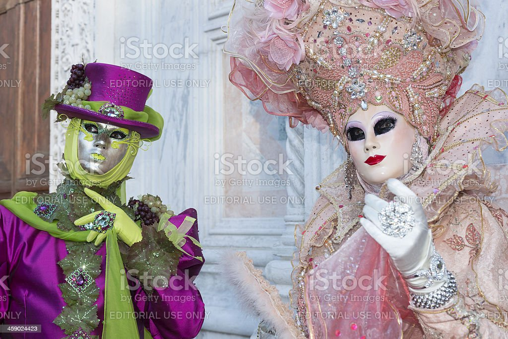Pink Purple-Green Masks in Venice 2013 Carnival Italy royalty-free stock photo