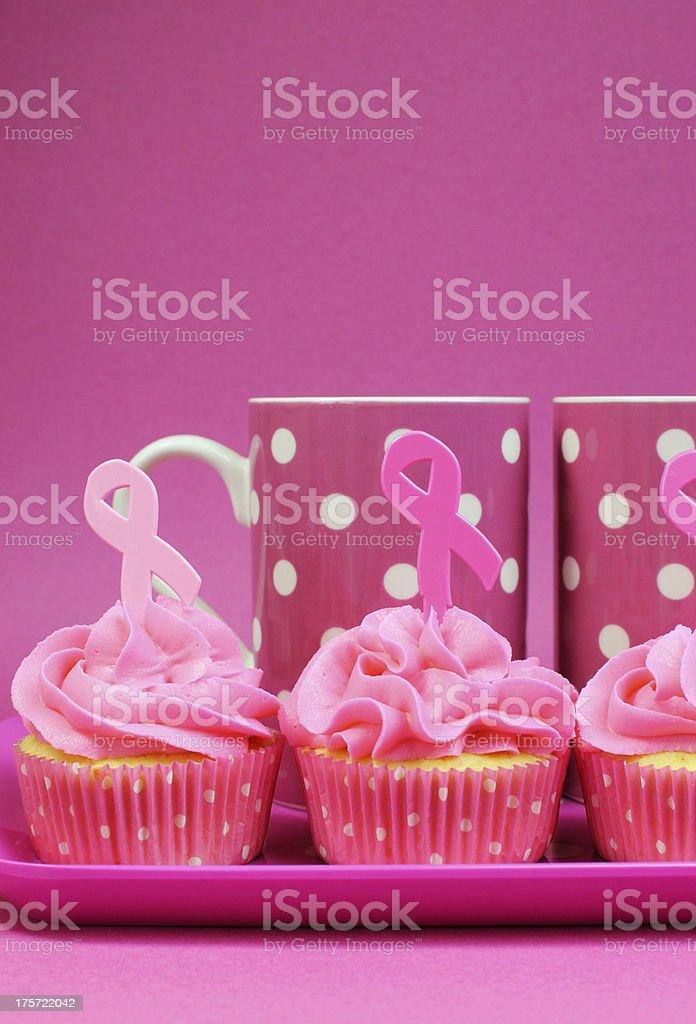 Pink Ribbon cupcakes and coffee mugs - vertical. royalty-free stock photo