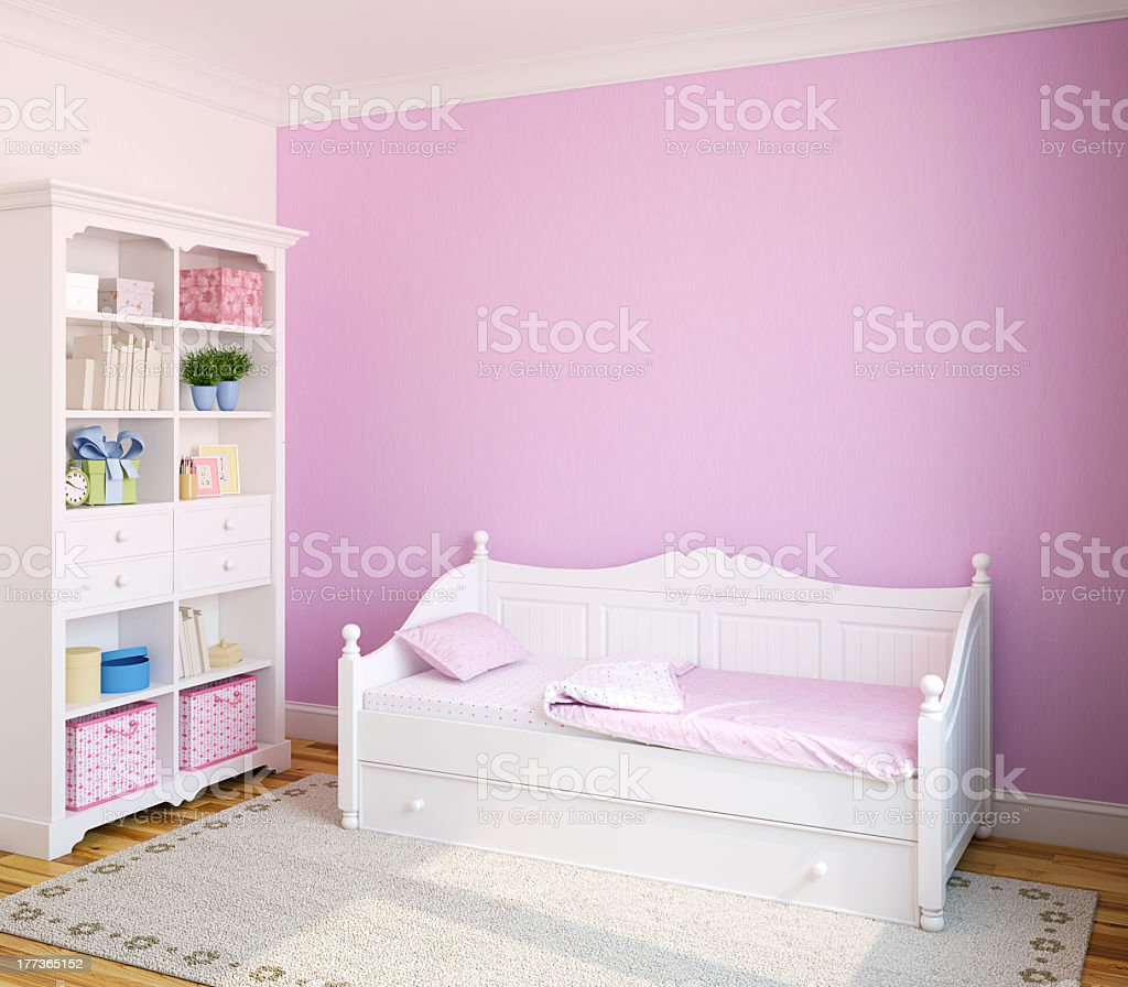 Pink room with white toddler bed and white bookshelf royalty-free stock photo