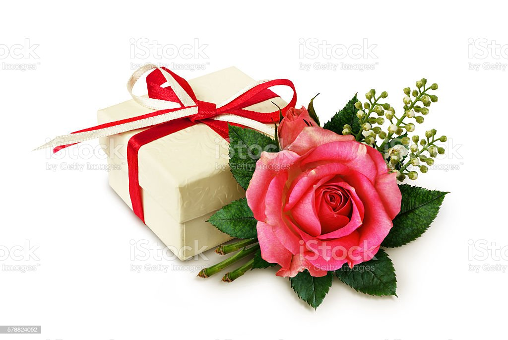 Pink rose flower arangement and a gift stock photo
