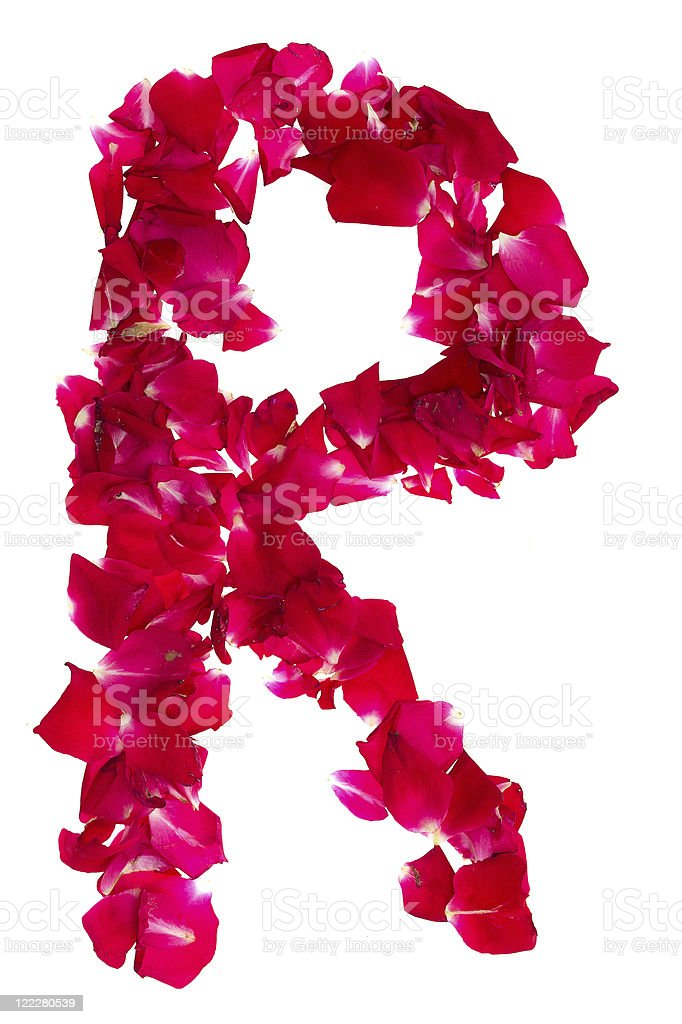 Pink rose petals forming letter R royalty-free stock photo