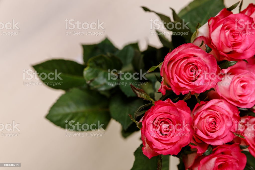 Pink roses background. Bouquet of fresh flowers. stock photo