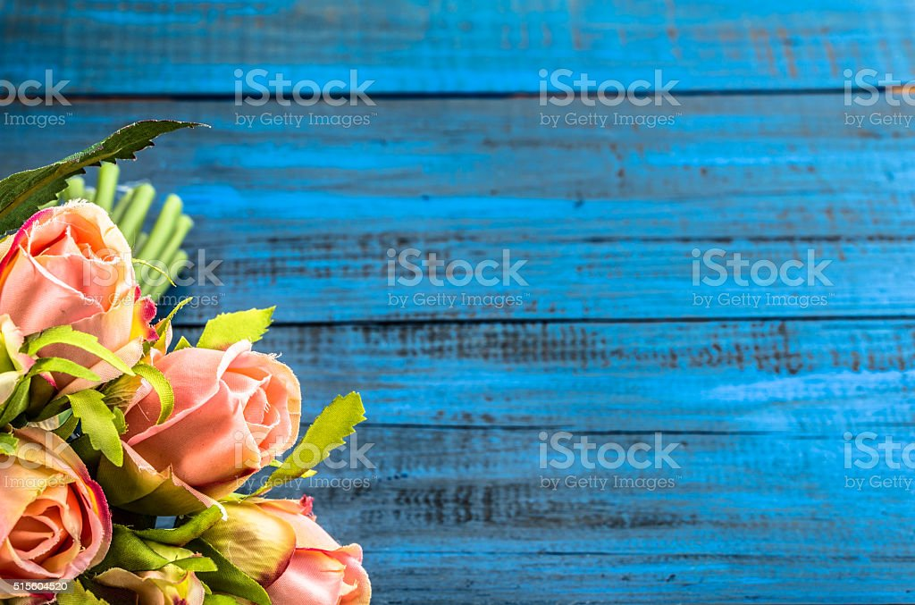 Pink roses flowers on wooden background, greeting card, mothers day stock photo