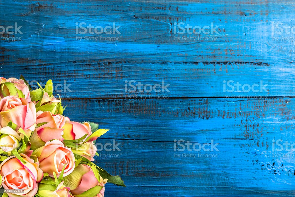 Pink roses flowers on wooden background stock photo