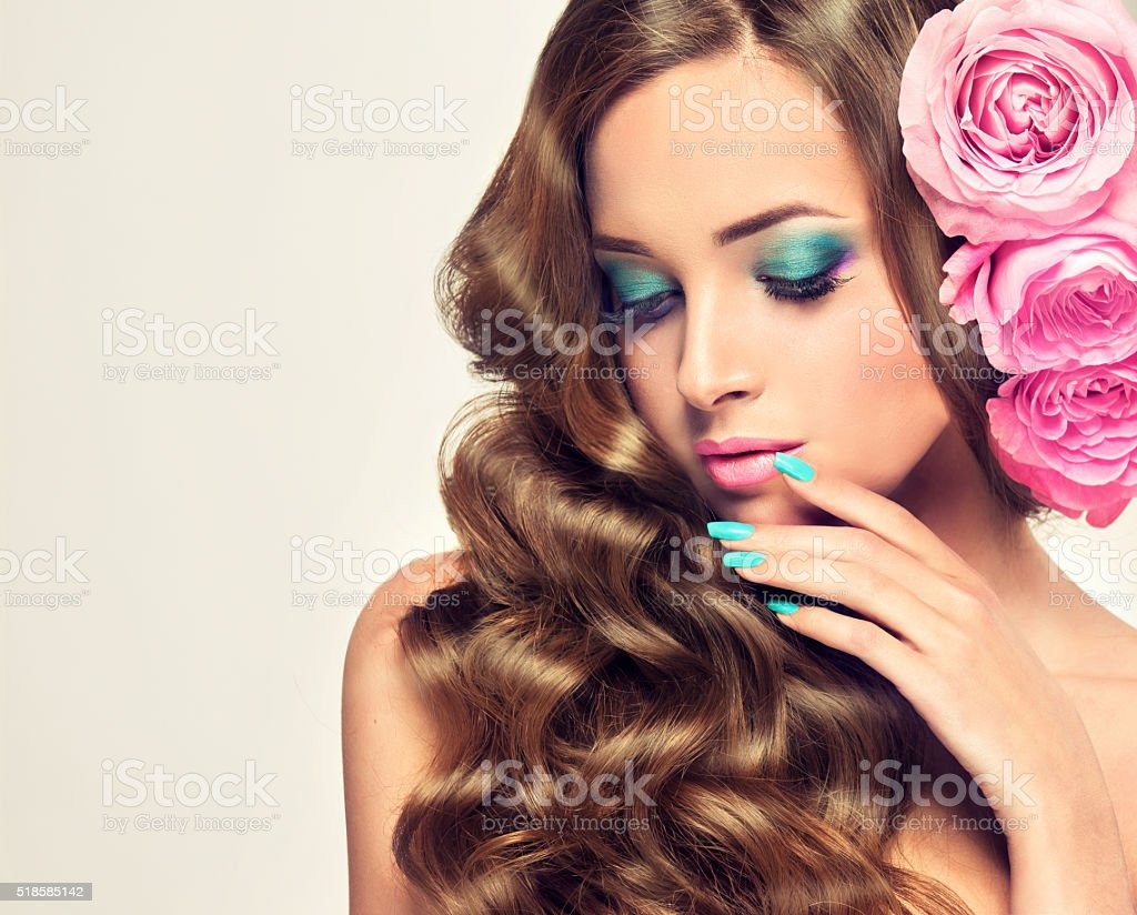 Pink roses in the hair. stock photo