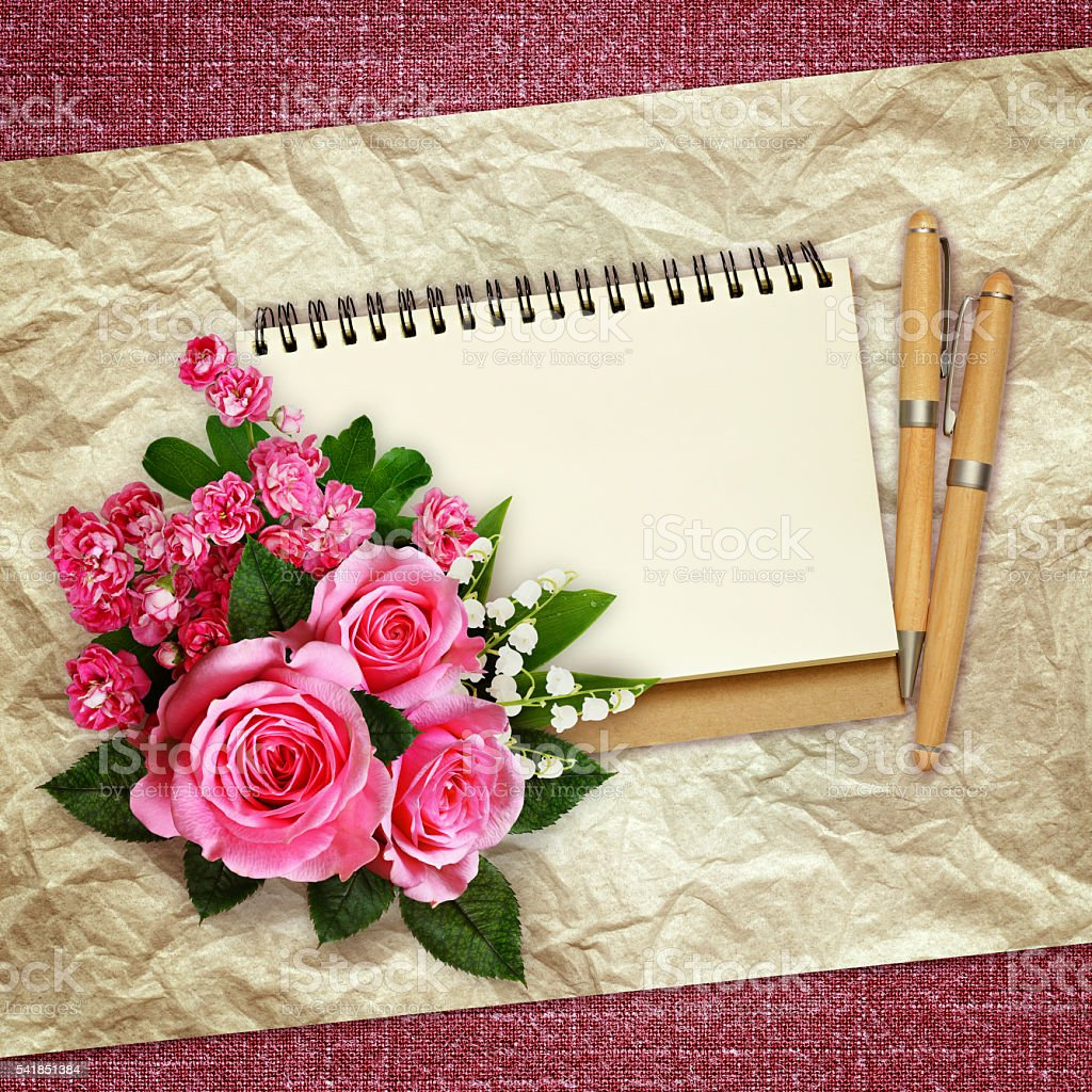 Pink roses, lilies of the valley and hawthorn flowers stock photo