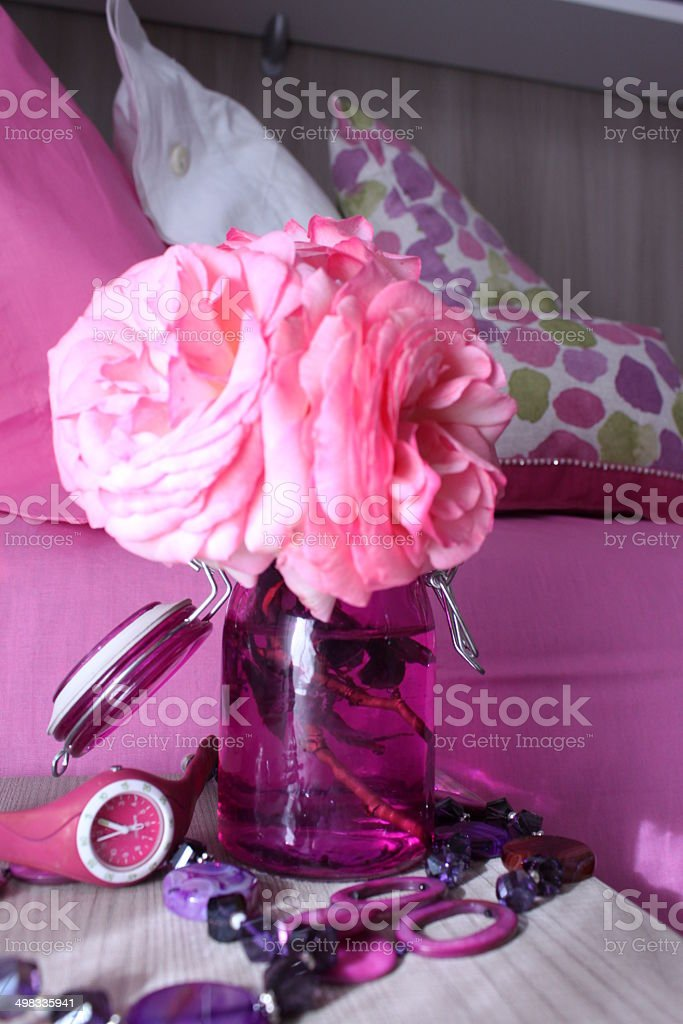 Pink roses, necklace and swatch on the left royalty-free stock photo