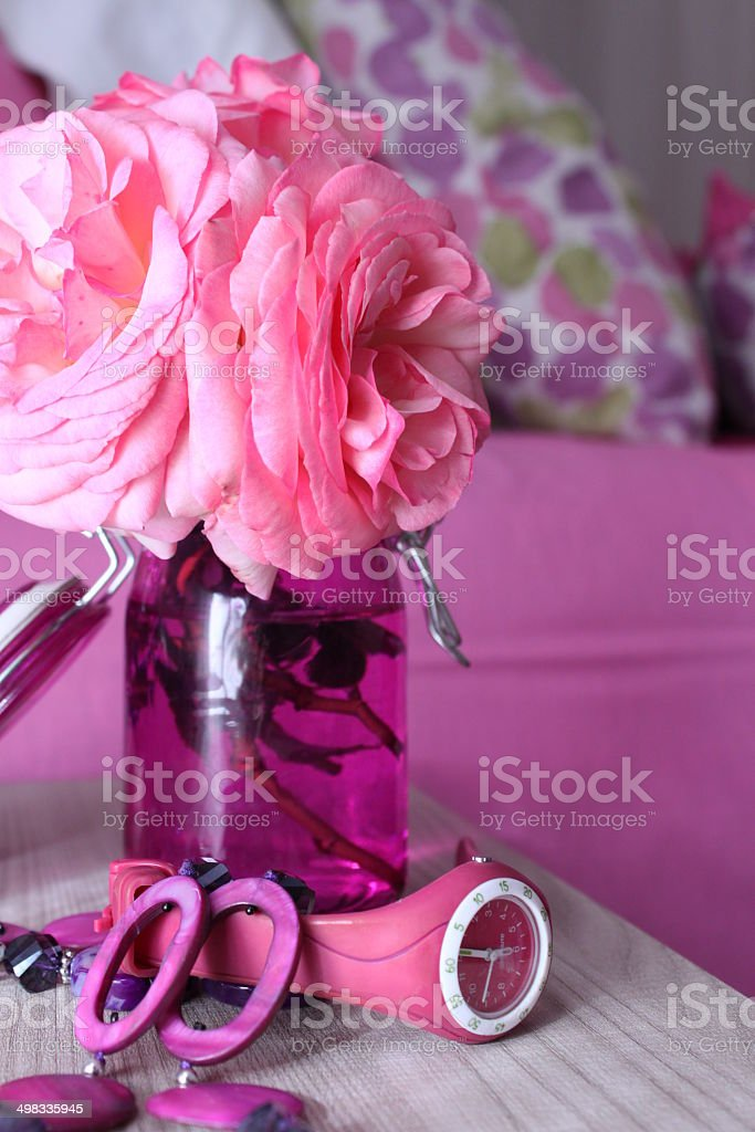 Pink roses, necklace and swatch on the right royalty-free stock photo