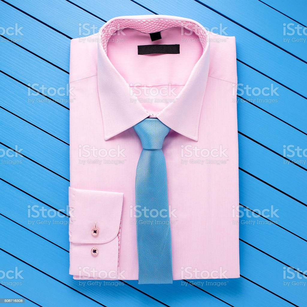 Pink shirt on wooden background stock photo