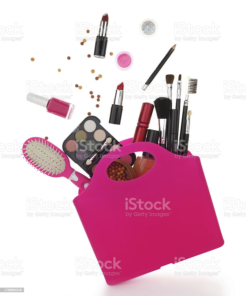 Pink shopping bag with various cosmetics isolated on white stock photo