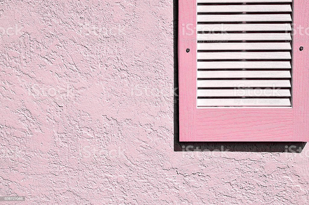Pink Shutter on Pink Exterior Stucco Wall stock photo